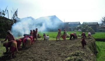 Women's communal work group preparing a field for off-season vegetables in Western Nepal. Photo Krishna Adhikari