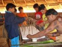 Elders and youths building a model of a traditional panara house brazil 2007 (E. Ewart)